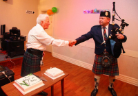 Bagpiper at a 80th Birthday Party